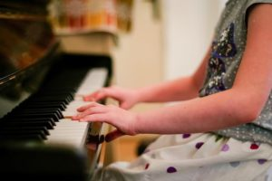 child playing piano at school